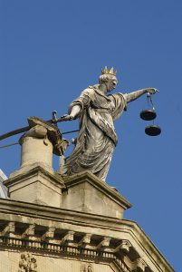 A Statue of Justice Surmounts the Pediment of The Guildhall, City of Bath